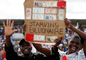Zimbabwe opposition Movement for Democratic Change supporters show old worthless banknotes at an election rally in Chitungwiza