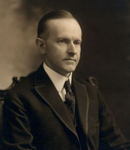 Calvin_Coolidge,_bw_head_and_shoulders_photo_portrait_seated,_1919